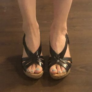 Worn twice Guess black leather wedges size 6.5